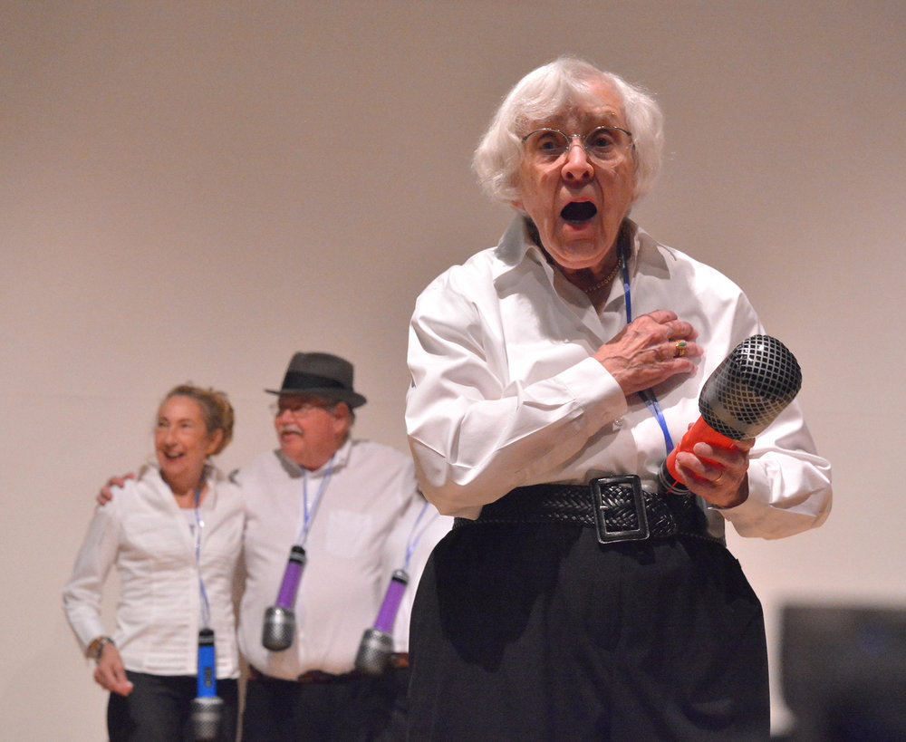 The   stAGES club  , a 50+ improv group, preformed a compilation of songs from throughout the decades.