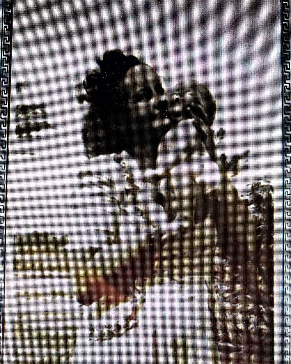 Linda's mother holding her as an infant.