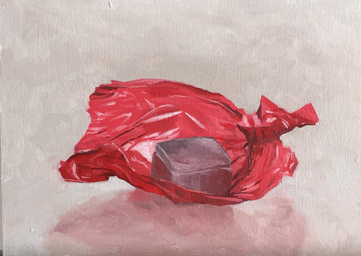 Untitled (red unwrapped foil candy)