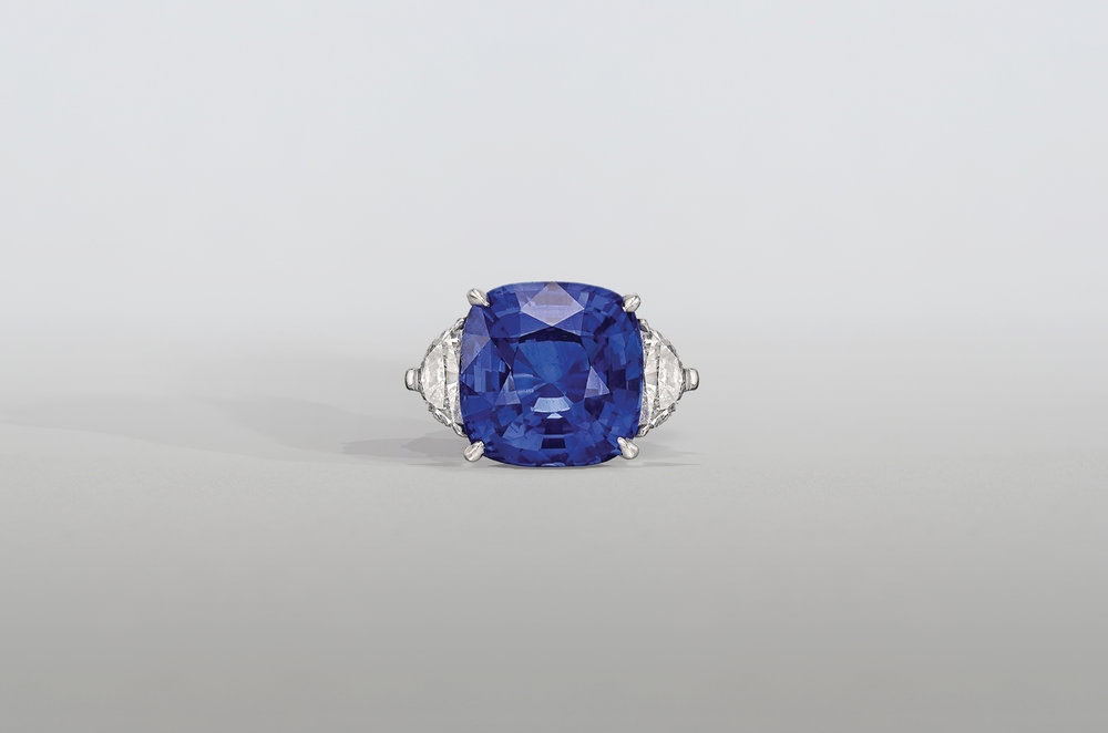 8.5 Carat Cushion Sapphire Ring with Trillion Diamonds set in Platinum