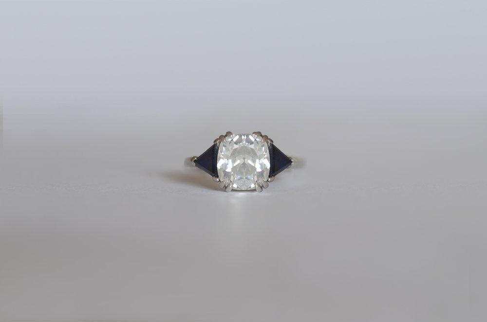 2.44 Carat Cushion Diamond with Trillion Sapphires set in Platinum
