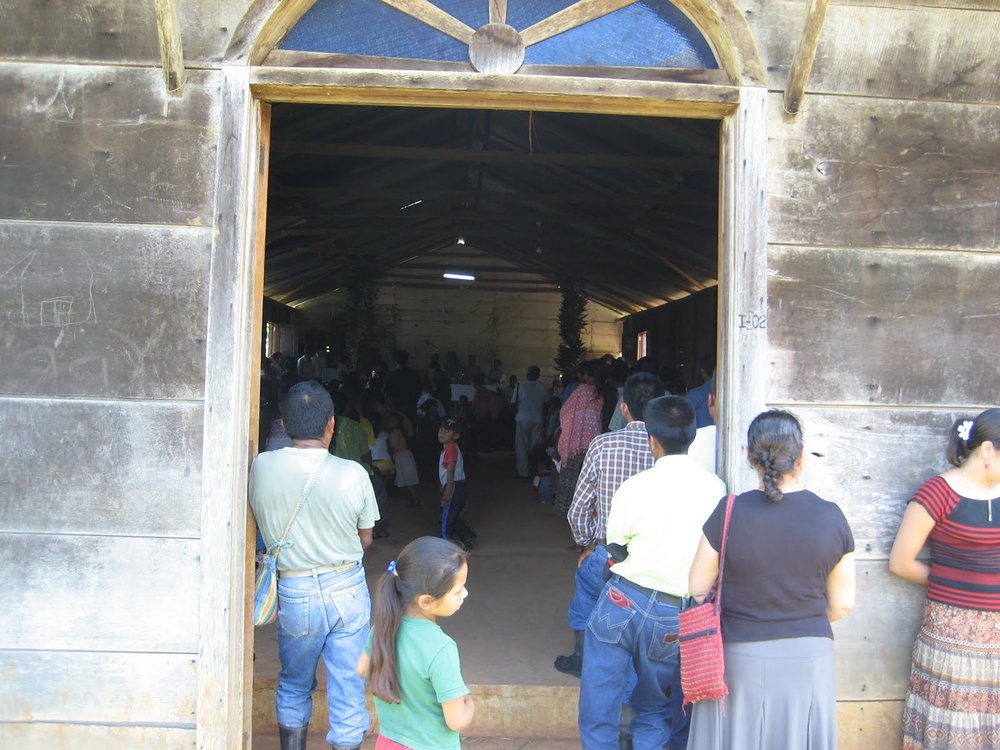 BVC Coban 2009 Mass in village.JPG