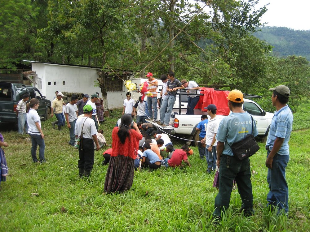 BVC Coban 2009 village with truck.JPG