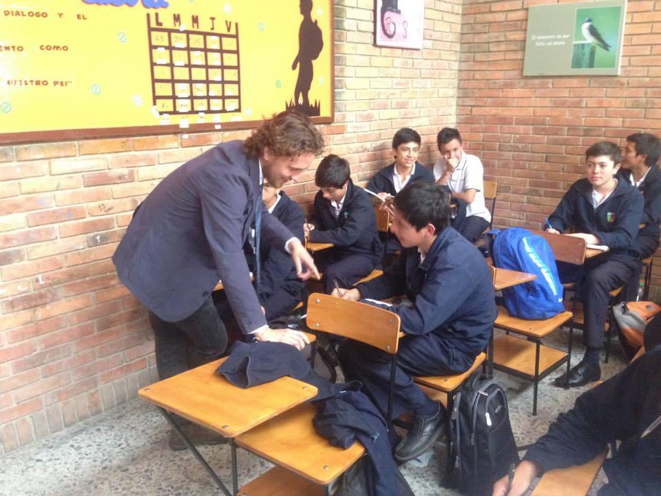BVC Bogota 2013 Jeremy Robak helping student.jpg