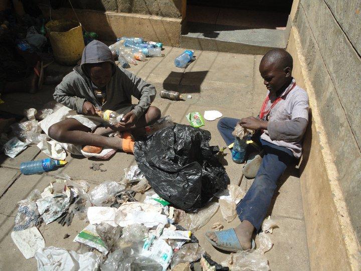 BVC Nairobi 2010 boys stuffing bottles.jpg