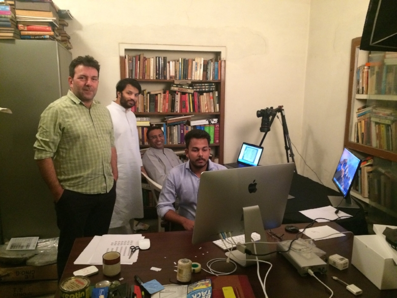 Raja of Mahmudabad Palace Library Project leader, Dr. Ali Khan Mahmudabad (center, in white), with project advisors Dr. Ignatius Payyappilly (Hill Museum and Manuscript Library) (background right) and Dr. Kevin Greenbank (Cambridge University) (left) on the first day
