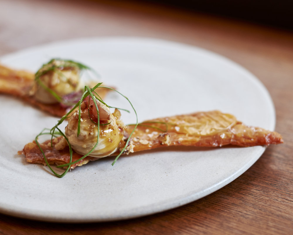Crispy chicken skins, liver parfait, candied walnuts & muscat grapes at Portland, London. Photo: TACA