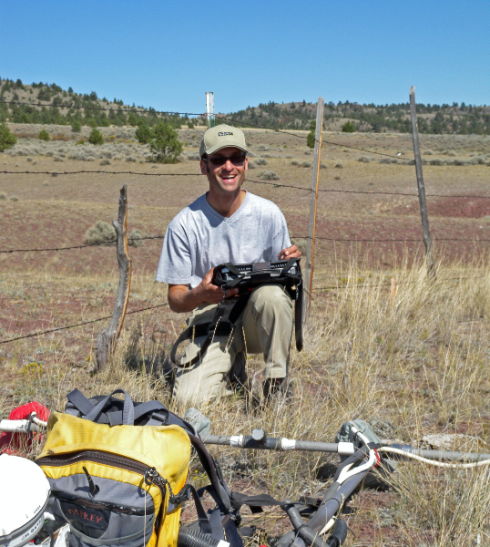 Joe readies the magnetometer for a magnetic survey.