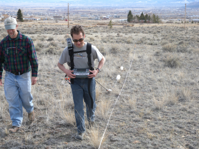 Joe and Mike conduct an apparent resistivity survey with the Ohm Mapper to determine soil conductivity.