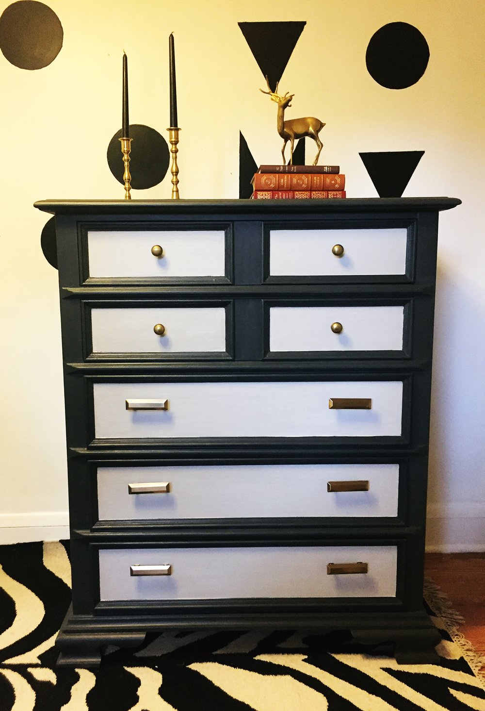 This vintage oak dresser was made by Drexel. I added a coat of light grey and charcoal chalk paint, kept the original brass knobs added new square beveled brass-look pulls from Martha Stewart. It will be for sale Saturday at the Rock 'n' Roll Famers Market.