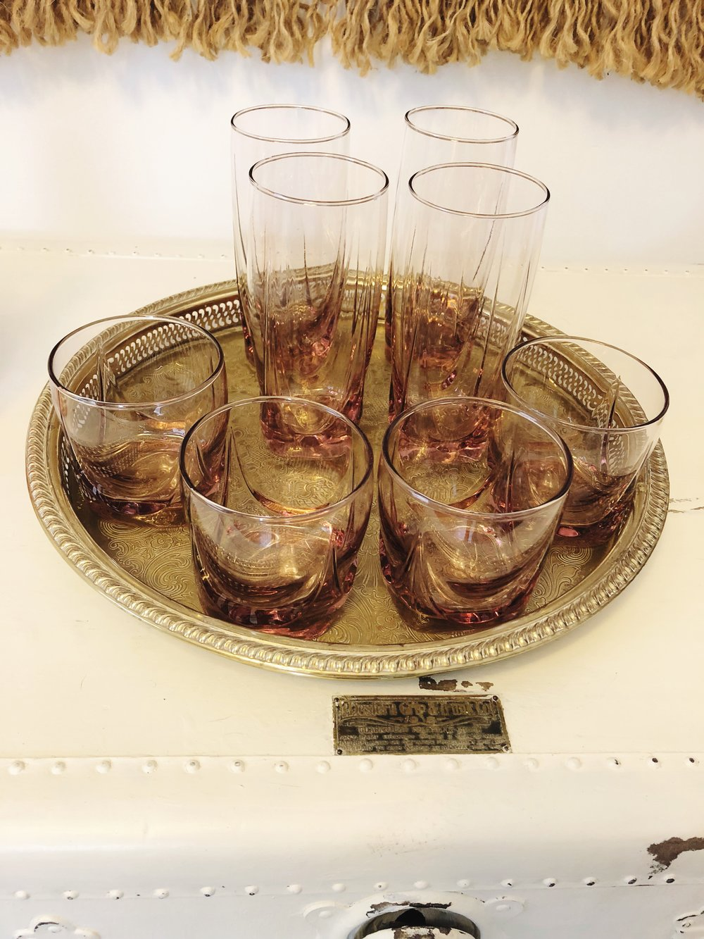 You can add this  8 piece set of pink vintage glassware  to your bar cart for $30.