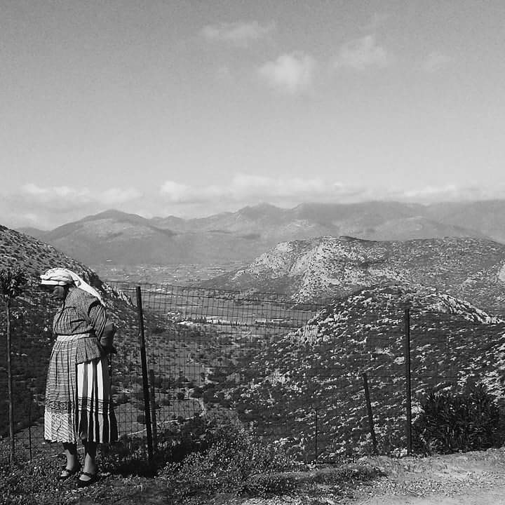 Traditional women's dress of Nestani as well as a breathtaking view of the mountains. Demi Frangos (2017)