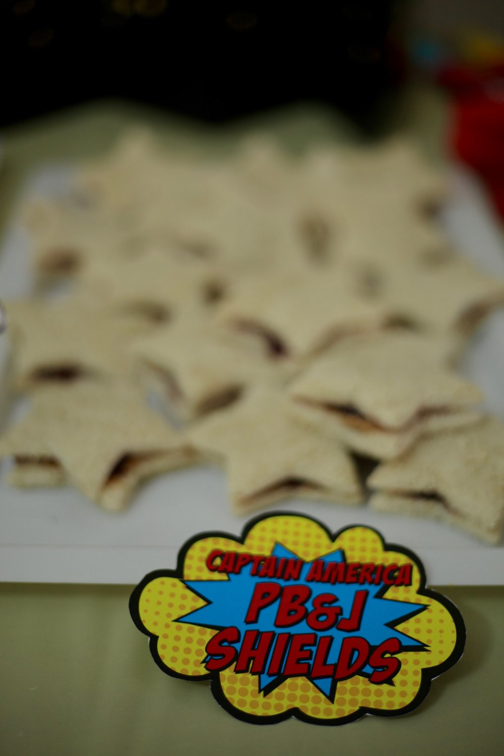 I cut PB&J sandwiches with a star cookie cutter for Captain America shields. (I had adult food on my kitchen island, buffalo chicken wraps, more fruit, black bean dip etc)