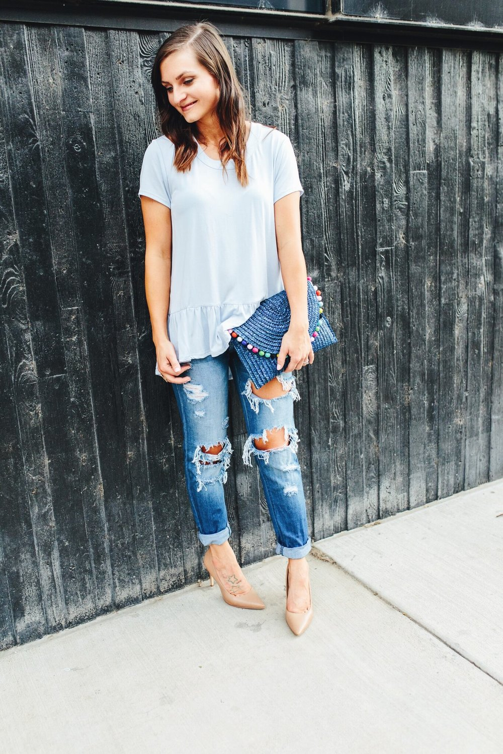 "<img src =""how-to-wear-boyfriend-jeans.jpg"" alt = ""Fashion-blogger-teddybearsandlipstick-showing-how-to-style-boyfriend-jeans-with-classic-sam-edeman-hazel-pumps-a-colorful-pompom-clutch-and-blue-peplum-top"">"