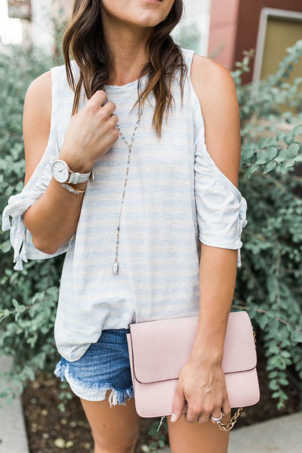 """<img src =""""five-summer-pieces-to-have-in-your-closet.jpg. alt="""" detail-shot-of-denver-fashion-blogger-styling-summer-pieces-to-have-in-your-closet-denim-cut-off-shorts-cold-shoulder-tee-and-steve-madden-jole-pearl-sandal-and-pink-handbags"""">"""