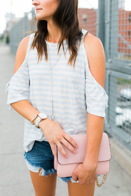 "<img src =""five-summer-pieces-to-have-in-your-closet.jpg. alt="" detail-shot-of-denver-fashion-blogger-styling-denim-cut-offs-cold-shoulder-top-and-pink-handbag"">"