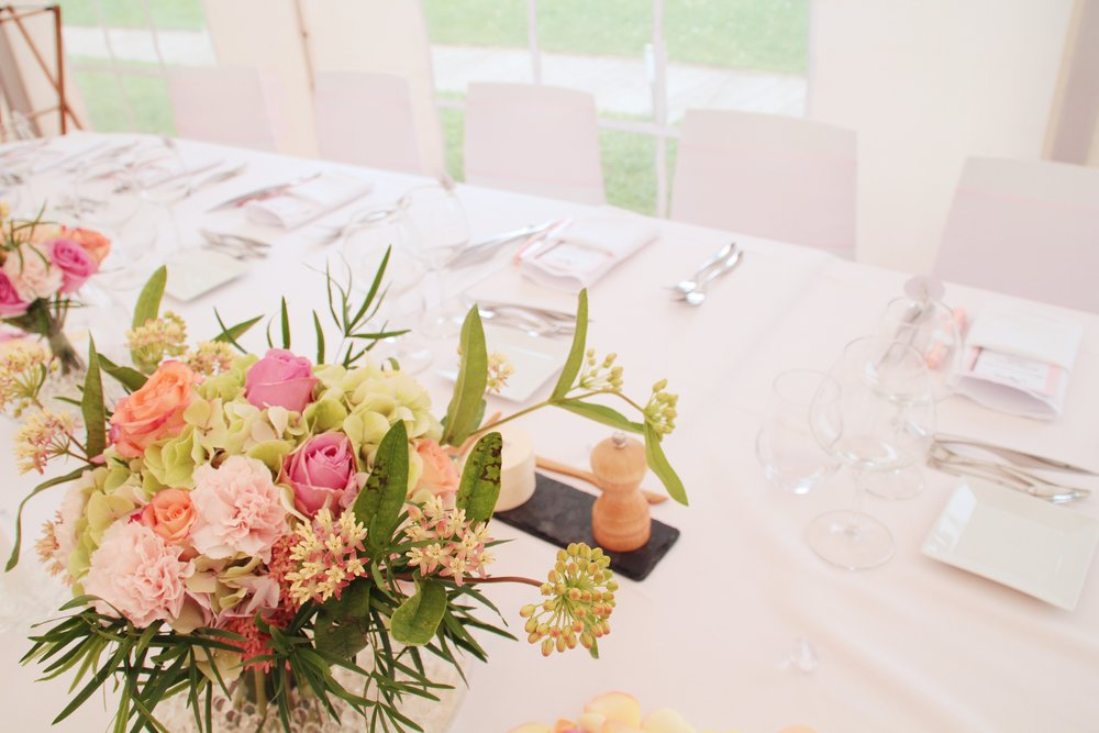 Pink & Yellow Floral Centerpiece With Crisp Linens