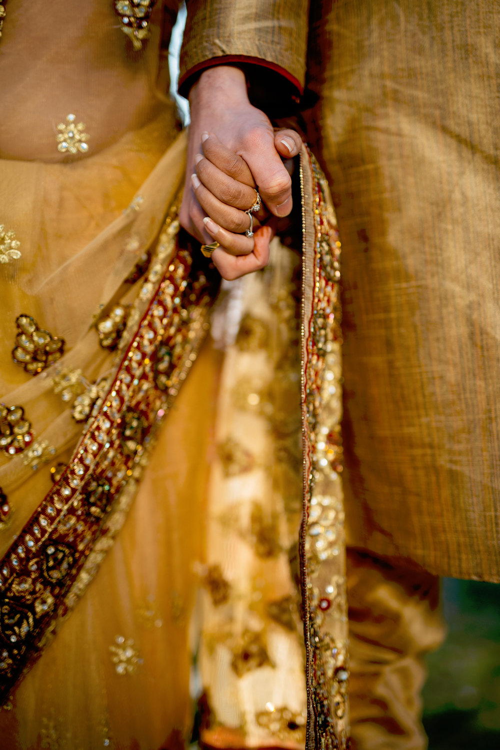 Indian Wedding Couple in Gold Textile with Ornate Beading.jpg