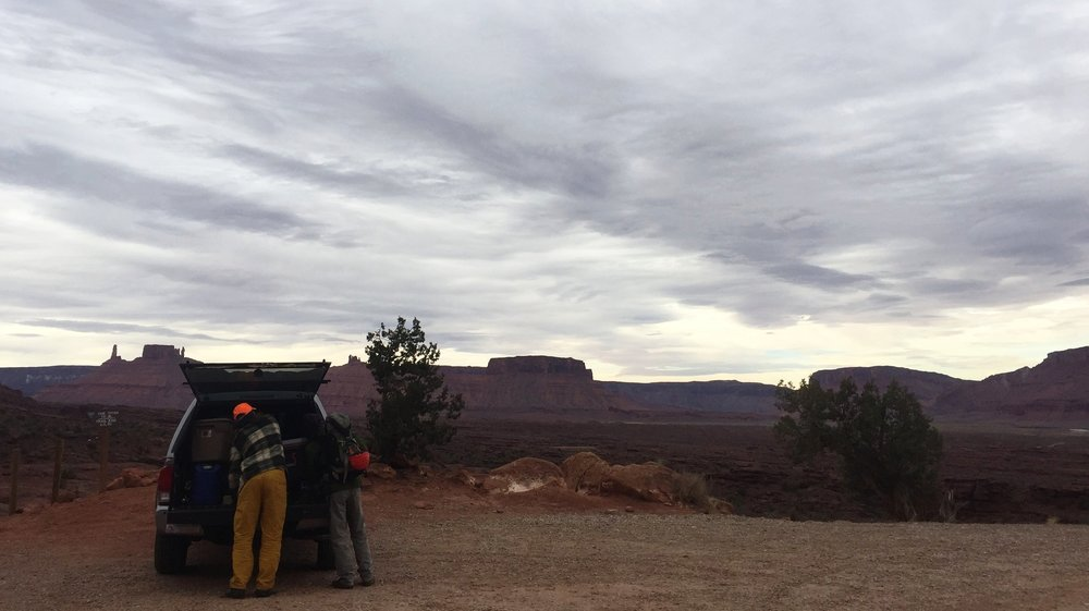 Climbers gearing up for a day out. Fisher Towers Trailhead, Moab, Utah.