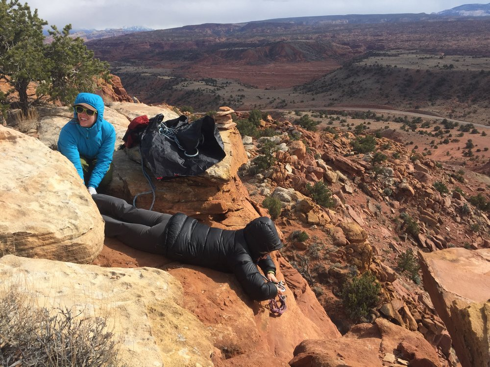 Safety first: Sarah sets a top rope anchor while Anna provides some enthusiastic backup at Cook's Mesa.