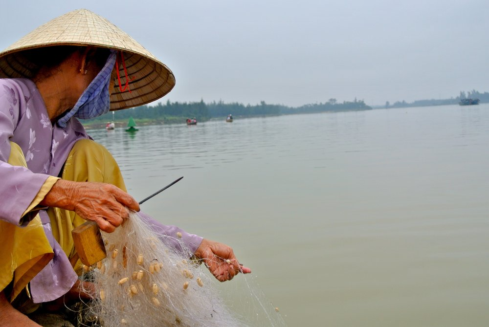 Woman Fishing in Hue, Vietnam