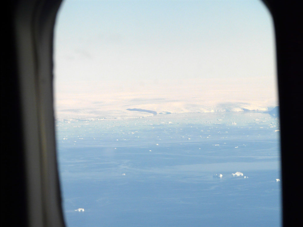 flying north toward Qaanaaq, the Greenland icecap spills directly into Melville Bay