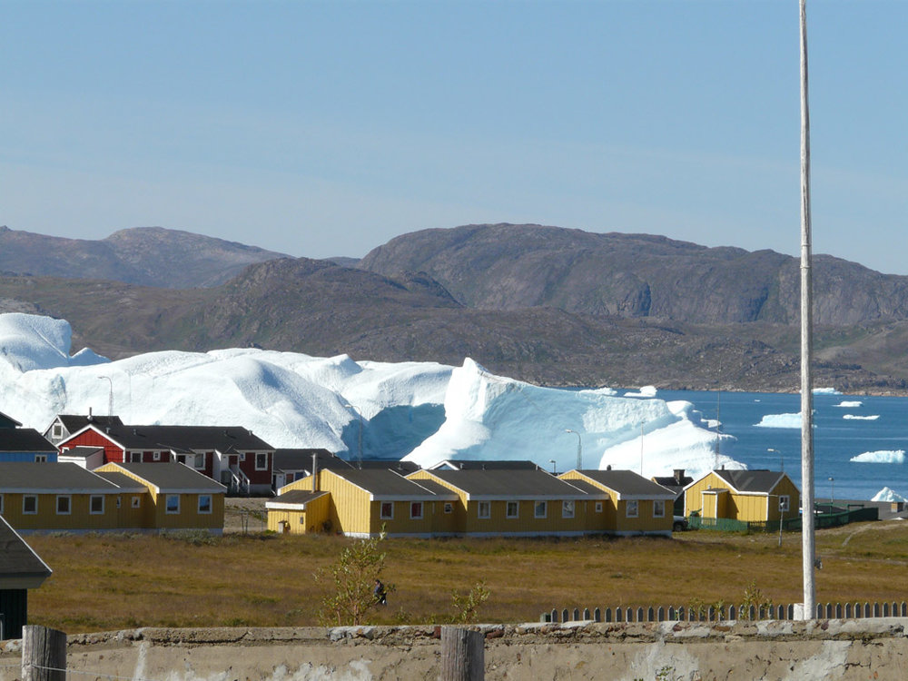 massive icebergs passing by the town