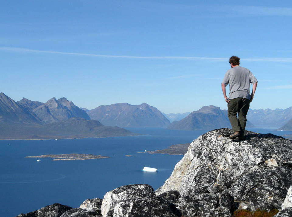 standing atop a mountain, overlooking the fjords