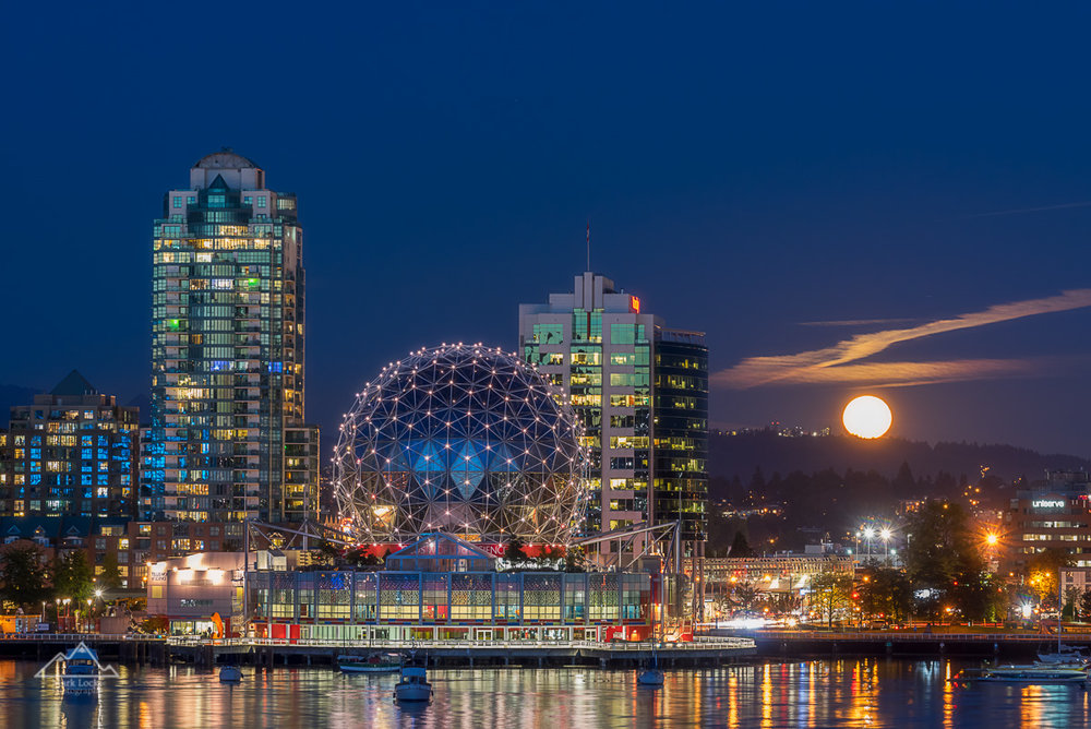 The Harvest Moon rising next to Science World in Vancouver, BC