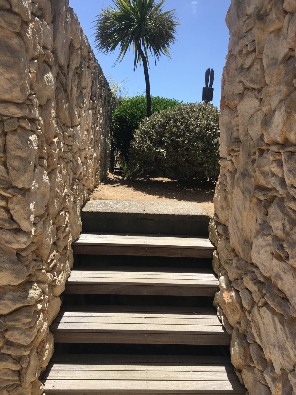 Narrow steps open to ocean views