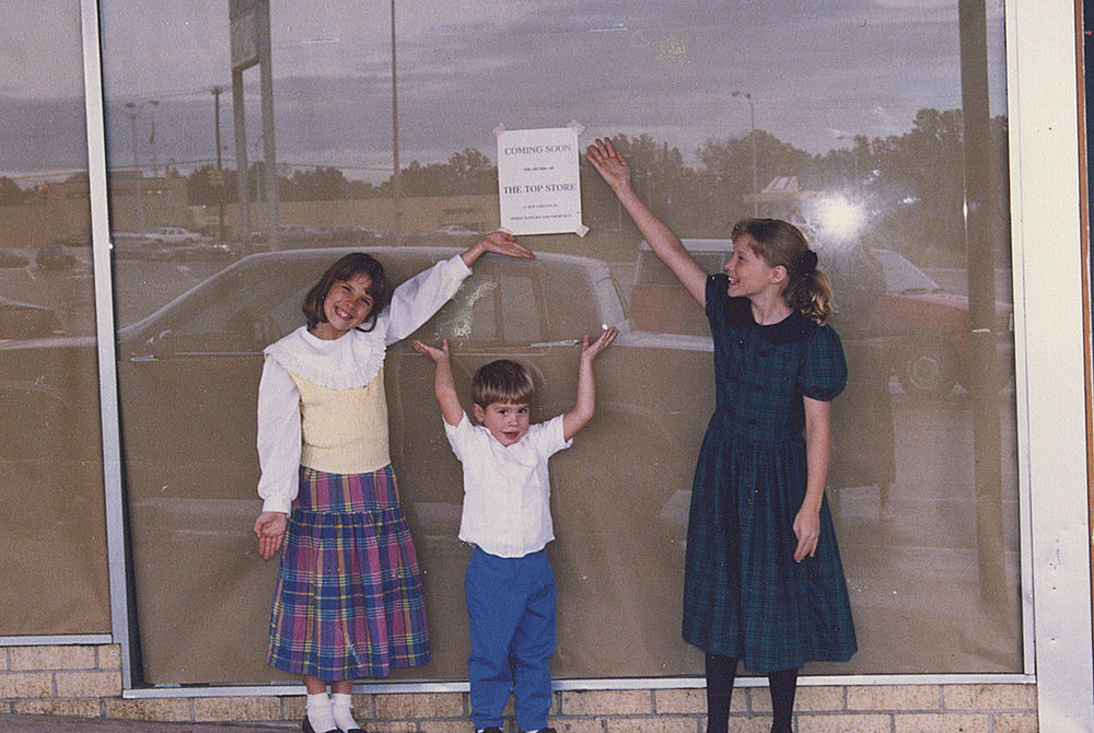 My sister, my brother and I standing in front of The T.O.P. store before it opened a few doors down from Service Merchandise