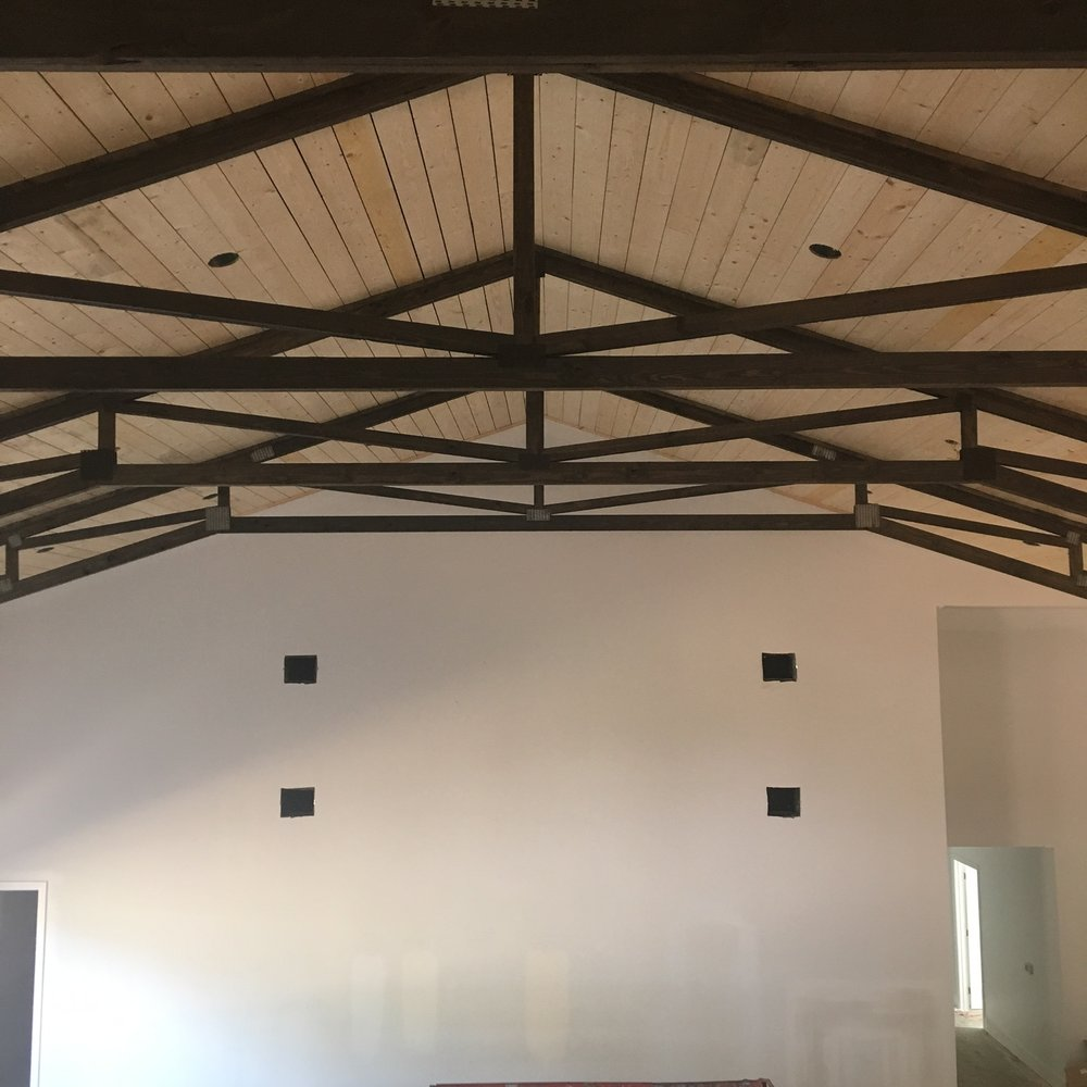 """Trusses with Kendall Charcoal """"Stain"""" (this image was taken before the walls were painted; you can still see paint samples on the wall)"""