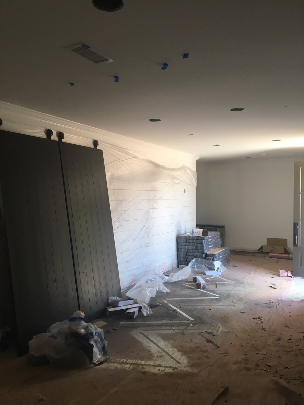 Construction Zone-interior doors being painted, flooring being installed and shiplap in the entrance. I can't wait for the 2 sconces to be installed in the next 2 weeks