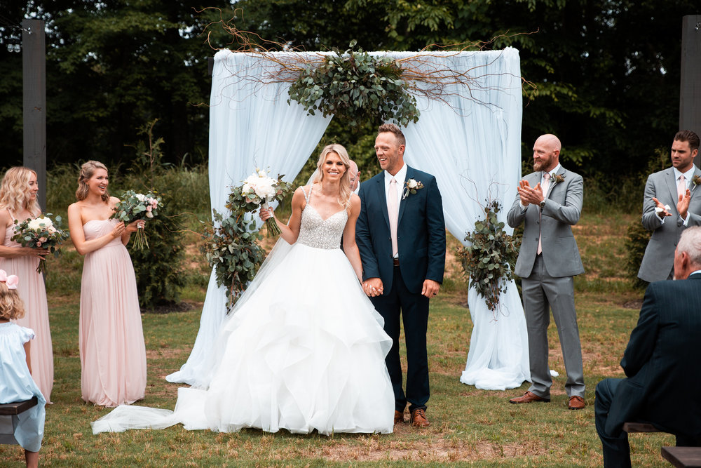 Bride and Groom in front of arbor