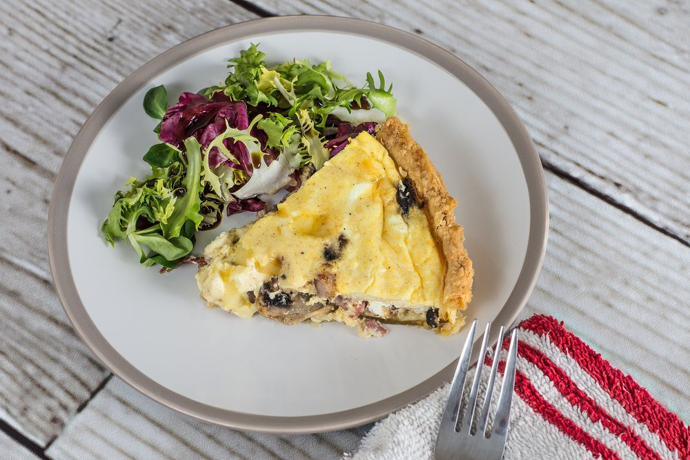 Quiche and spring mix salad