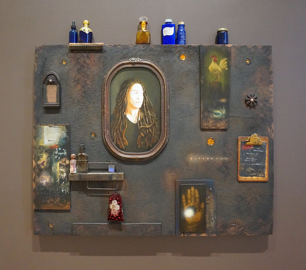 Renee Stout, The Black Wall, 2008  34 x 42.5 x 4.5 in.  Acrylic, mixed media, wood, glass and metal on plywood panel