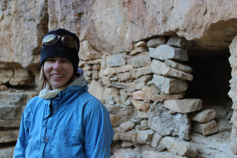 Tory poses at some Anasazi ruins.