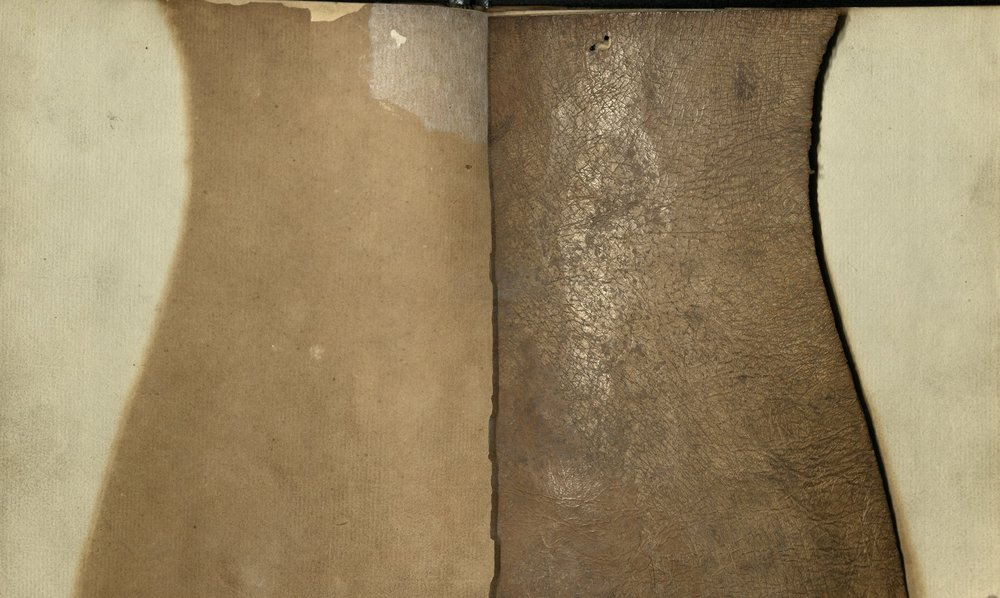 On the right hand side of this image is the purported skin of Charles Smith. The left hand page shows the marks that the page has left.