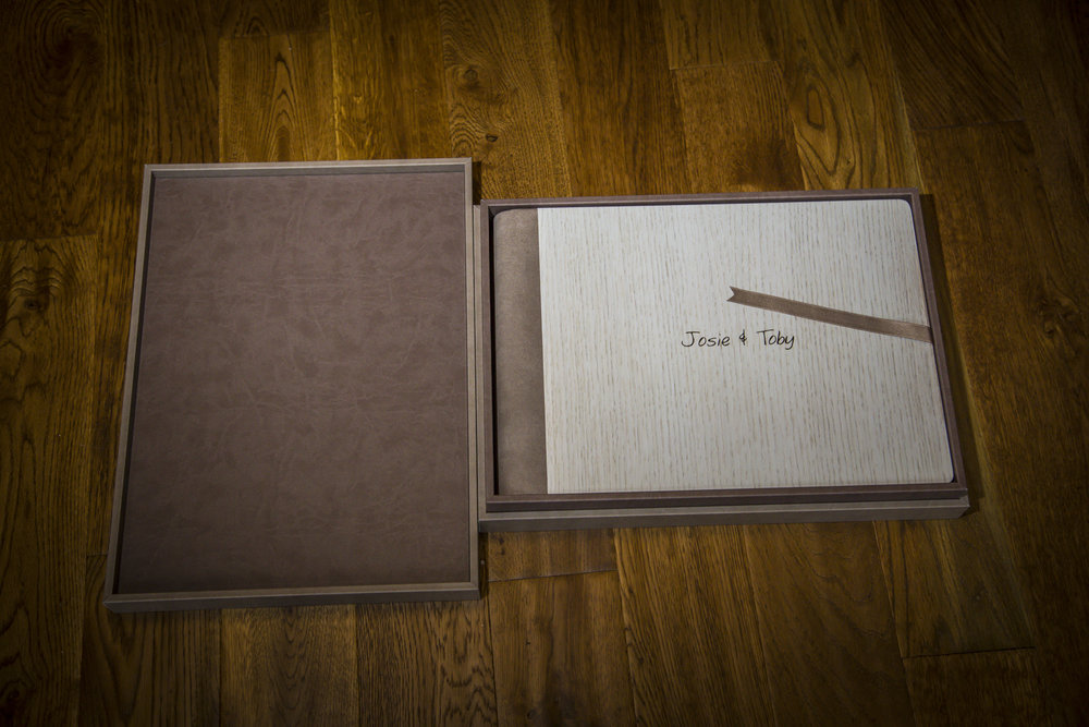 The interior of the design box and the album encased in it.