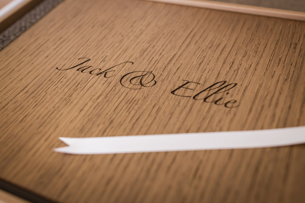 Wood oak cover with engraved writing and white ribbon