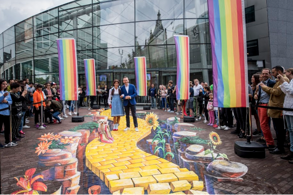 Museum director Axel Rüger walks the Yellow Brick Road with fictional character Dorothy.   via  vangoghmuseum