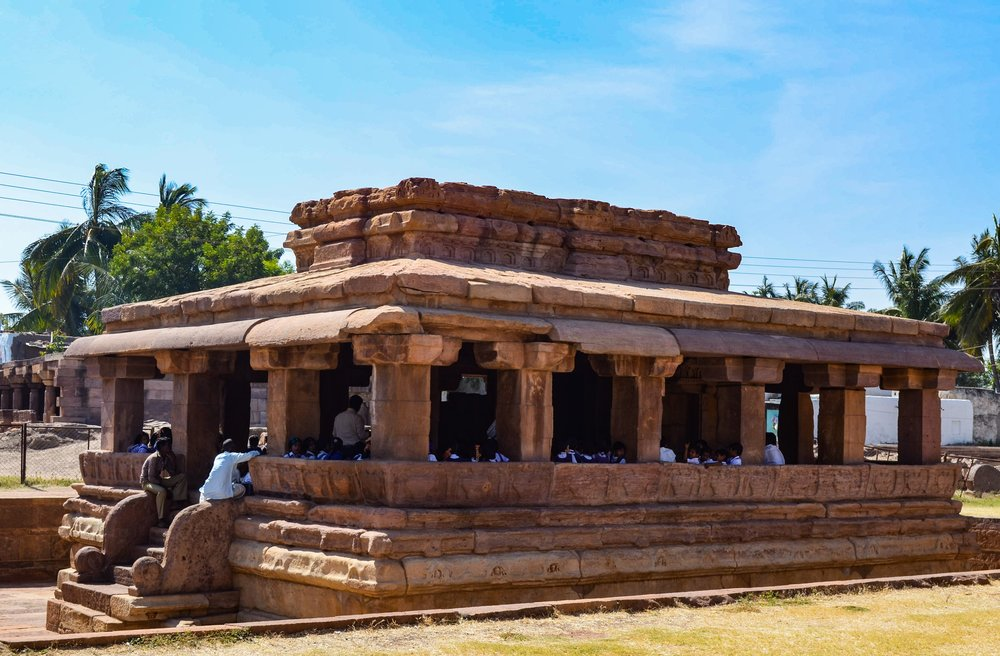 Aihole, November 2017. In the mid-morning heat, the kids sat protected inside.