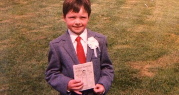 'In hand-me-down wool blazer and red tie, clutching a holy book, my communion photo made me look like Mormon-meets-mini-Tory. I was delighted with myself and the suit has served as camouflage ever since.'