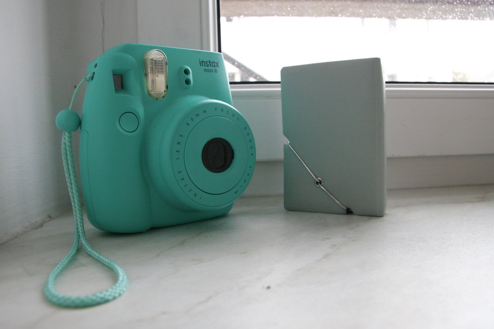 Polaroid Camera and Polaroid Album from Urban Outfitters