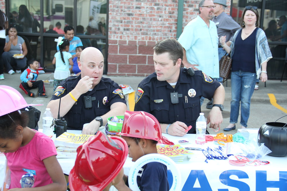 Police officers meet the public at National Night Out at Nash City Hall.