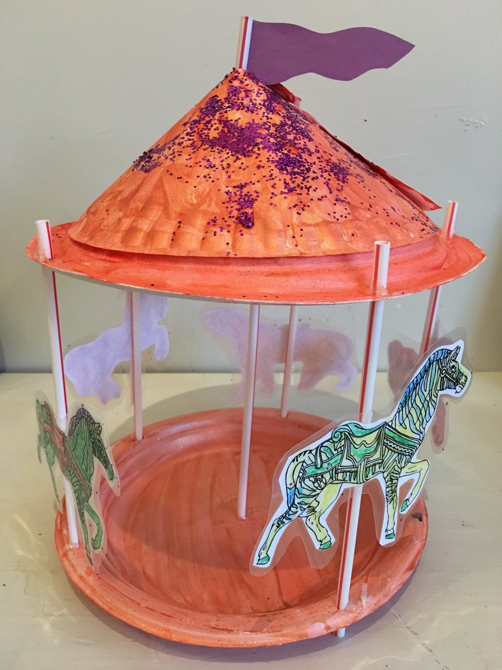 Mixed media assembled carousel with paper cut outs!