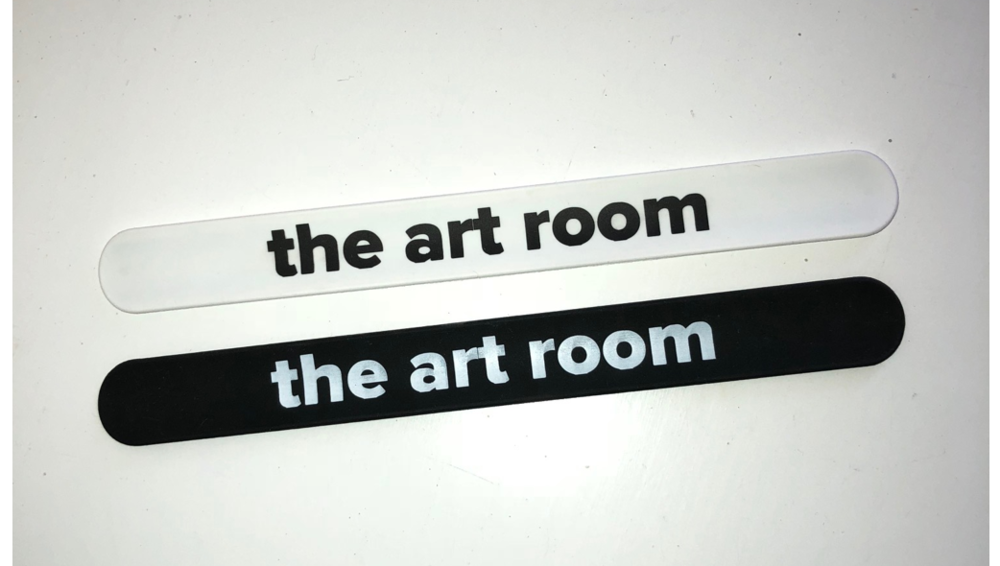 """Slap"" bracelets, black or white.   Purchase your Art Room bracelets    here   !"