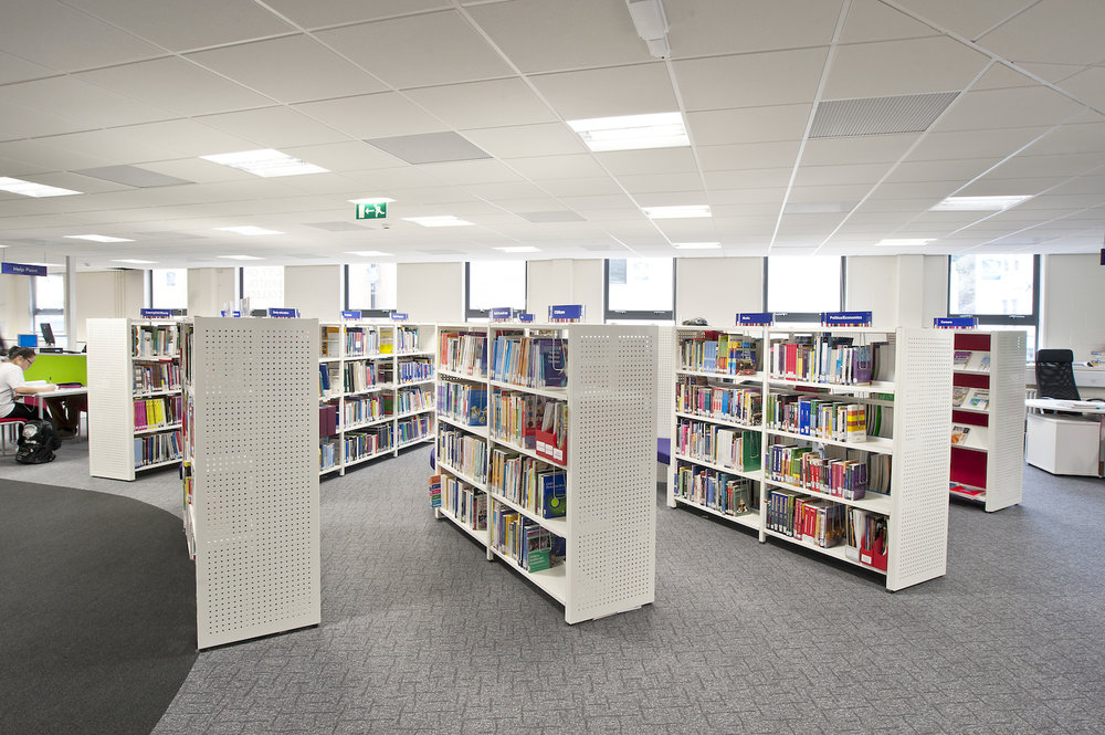 White double sided Aspire shelving with perforated steel end panels
