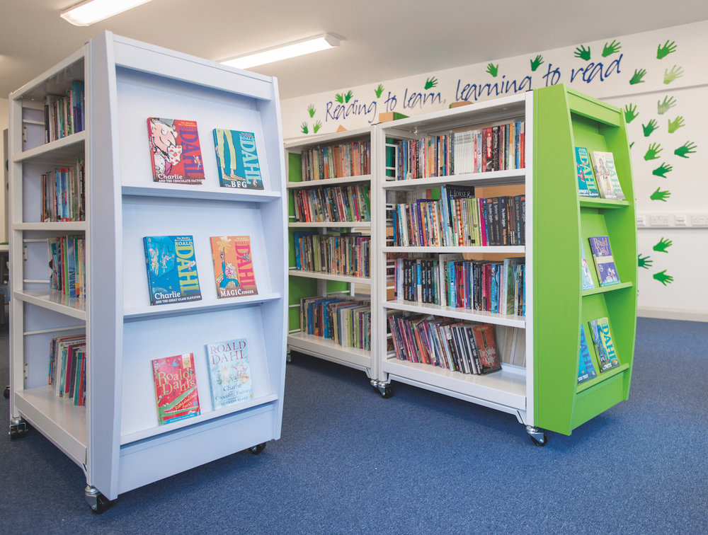 Display end panels in school colours on double sided shelving bays enhance display capacity and reinforce branding.