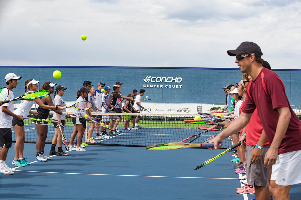 Bryan bros and kids passing balls_Concho court.jpg